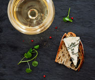 Glass of wine and cheese Stock Photos