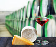 Glass of wine and cheese in winery Stock Images