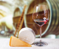 Glass of wine and cheese in winery Stock Photography