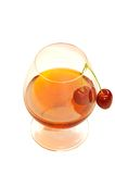 Glass of wine and cherries Royalty Free Stock Image