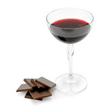 Glass of wine and chocolate. Isolated on white background Royalty Free Stock Photos