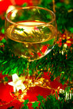 Glass of wine with Christmas decoration Stock Images