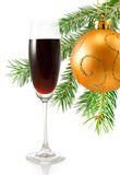 Glass of wine and Christmas decoration closeup Stock Image