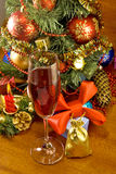 Glass of wine on Christmas tree background Royalty Free Stock Photos