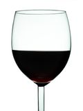 Glass of wine close-up. Glass of red wine close-up isolated over white background royalty free stock photos