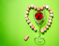 Glass of wine with cork stoppers Stock Images