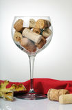 Glass with wine corks Stock Image