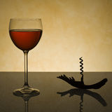 Glass of Wine and Corkscrew Royalty Free Stock Photography