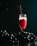 Glass of wine on a dark background Stock Images