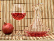 Glass of wine, decanter and pomegranate Royalty Free Stock Image