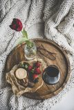 Glass of wine, different snacks and red tulip in jar stock image