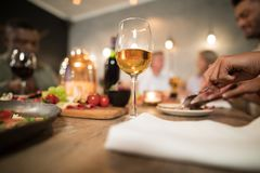 Glass of wine on dining table. In restaurant stock photos