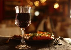 Glass of wine and dinner beside stock photo