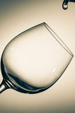 The glass of wine and the drop of water. Stock Photos