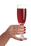 A glass of wine in a female hand Stock Images