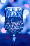 Glass of wine. With festive light effects background Stock Image
