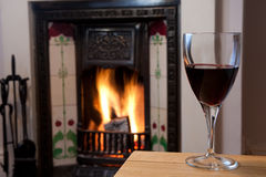 Glass of Wine by the Fire Stock Photography