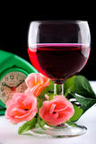 Glass of wine, a flower and watch Stock Photography