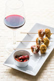 Glass of wine with food Stock Image