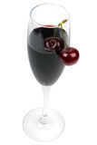 Glass of wine and fresh cherries Stock Image