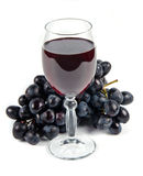 Glass with wine and fruit Royalty Free Stock Photo