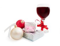 Glass with wine and gifts Royalty Free Stock Image