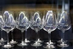 Glass wine glasses stand in a row royalty free stock image