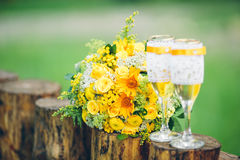 Glass wine glasses and wedding bouquet Stock Images