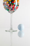 Glass of wine and golf equipments royalty free stock photos