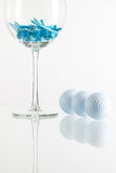 Glass of wine and golf equipments Stock Photography