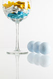 Glass of wine and golf equipments Royalty Free Stock Images