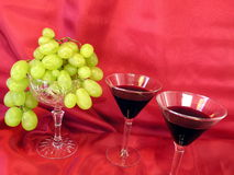 Glass wine and grape Stock Images