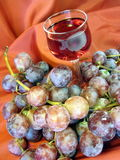 Glass of wine and grape stock photography