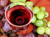 Glass of wine and grape royalty free stock photography