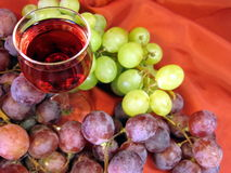 Glass of wine and grape royalty free stock image