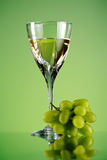 Glass of wine and grape bunch Royalty Free Stock Images