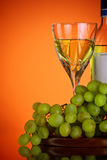 Glass of wine and grape bunch Stock Image