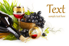 Glass of wine with grapes Stock Image