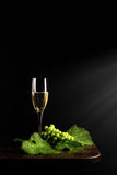 Glass of wine. And grapes Stock Images