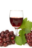 Glass of wine and grapes Stock Photos