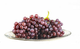 Glass of wine and grapes, isolated on white Stock Images