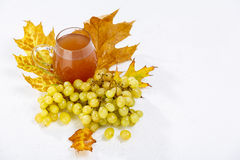 Glass of wine with grapes and leaves Royalty Free Stock Photography