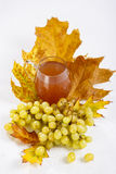 Glass of wine with grapes and leaves Stock Photos