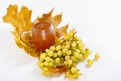 Glass of wine with grapes and leaves Stock Photo