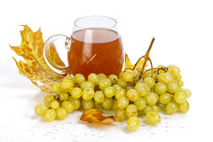 Glass of wine with grapes and leaves Royalty Free Stock Image