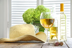 Glass of wine with hat on table Royalty Free Stock Photos