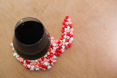 Glass of wine and hearts Stock Image