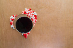 Glass of wine and hearts Stock Photography