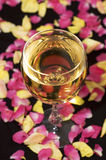 Glass of wine with leaves Royalty Free Stock Image