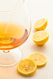 A glass of wine with  lemon Stock Images